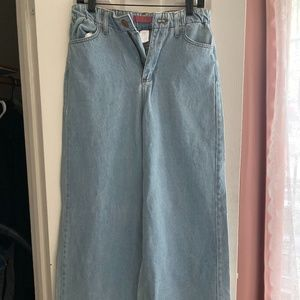 Fun & Flirty Flared Jeans with a Distressed Hem